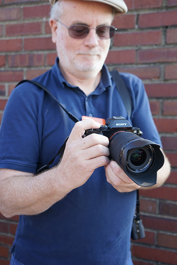 Photographer and writer John Rettie holding the Sony Alpha 7.