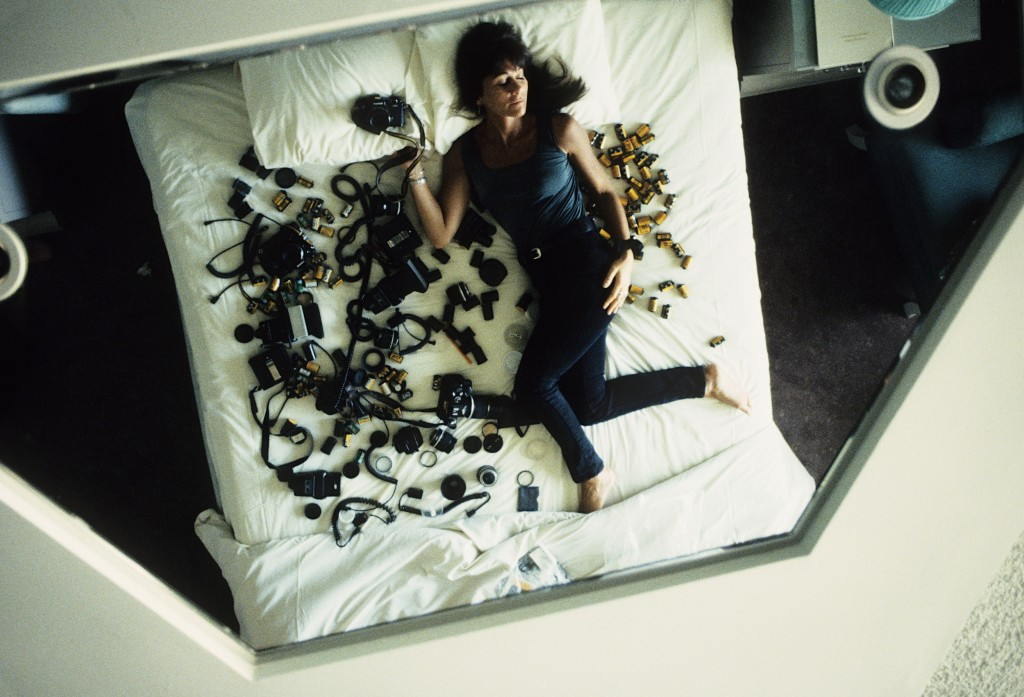 Lynn Goldsmith sleeping with cameras.